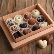 Delicious chocolate candies in gift box on table close-up — Stock Photo #63132699