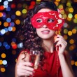 Beautiful girl with masquerade mask and glass of champagne on bright background — Stock Photo #63134521