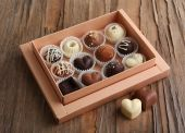 Delicious chocolate candies in gift box on table close-up — Stock Photo