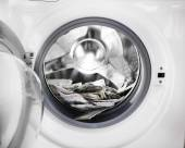 Money in washing machine, closeup view — Stock Photo
