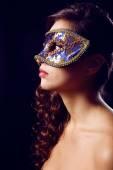 Beautiful girl with masquerade mask on dark background — Stock Photo