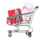 Small shopping cart full of gifts, isolated on white — Stock Photo