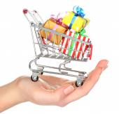 Female hand with small shopping cart full of gifts, isolated on white — Stock Photo