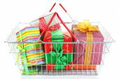 Metal basket full of present boxes isolated on white — Stock Photo