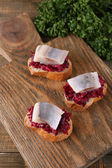 Herring with beets on rye toasts — Stock Photo