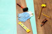Carpenter tools on new laminate floor — Fotografia Stock