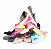 Pile of various female shoes — Stock Photo