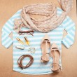Fashionable female clothing and accessories, on wooden background — Stock Photo #63169387