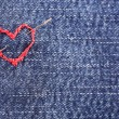 Jeans fabric with red heart embroidered on it, close-up — Stock Photo #63169811