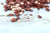 Coffee beans on light blue wooden background — Стоковое фото