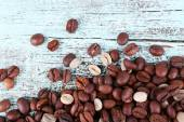 Coffee beans on light blue wooden background — Stockfoto