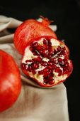 Juicy ripe pomegranates on dark background — Foto de Stock