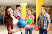 Portrait of friends in bowling club — Stock Photo