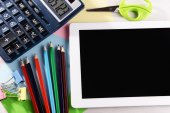 Tablet PC with office supplies on desktop background — Foto Stock