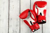 Pair of boxing gloves on color wooden background — Stock Photo