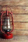 Kerosene lamp on wooden planks background — Stock Photo