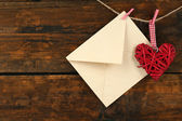 Love letter hanging on rope on rustic wooden background — Stok fotoğraf