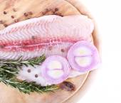 Pangasius fillet on wooden cutting board with pepper and rosemary sprigs isolated on white — Stock Photo
