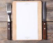 Cutting board with menu — Stock Photo