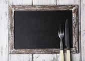 Menu board on color wooden planks background — Stock Photo