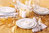 Beautiful holiday table setting in white and gold color  — Stock Photo