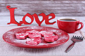 Romantic still life with cookies in form of heart on color wooden planks background — Stock Photo