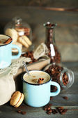 Beautiful composition with tasty cappuccino on wooden table — Stock Photo