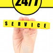 Word Service formed with yellow cubes in hand, Round-the-clock service concept — Stock Photo #63215689