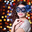 Beautiful girl with masquerade mask on bright background — Stock Photo #63218187