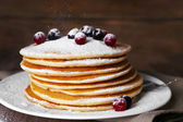 Pancakes with powdered sugar, berries — Stock Photo