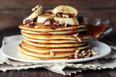 Pancakes with chocolate, honey, nuts — Stock Photo