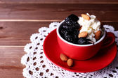 Dessert with prunes and almonds — Stock Photo