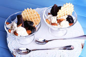 Dessert with prunes in bowl — Stock Photo