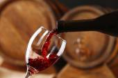 Pouring red wine from bottle — Stock Photo