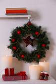 Christmas wreath on shelf — Stock Photo