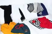Messy clothing on white sofa — Stock Photo