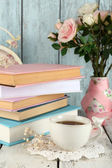 Cup of tea with books and flowers — Stock Photo