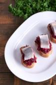 Toasts with herring and beets — Stock Photo
