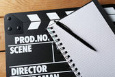 Movie clapper with notebook — Photo