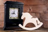 Retro clock with decorative horse — Stock Photo