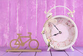 Alarm clock with decorative bicycle — Stock Photo