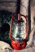 Kerosene lamp with wreath on wooden planks background — Foto de Stock
