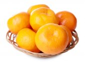 Tangerines in basket isolated on white — Stock Photo