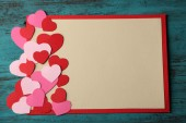 Hand made card with hearts — Stock Photo