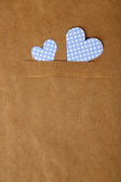 Paper hearts on brown background, close up — Stock Photo