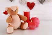 Teddy bear with candle, love concept — Stockfoto