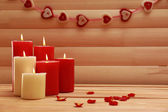 Romantic candles on wooden background, love concept — Stock Photo