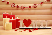 Romantic candles on wooden background, love concept — Stockfoto