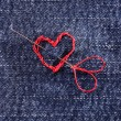 Jeans fabric with red heart embroidered on it, close-up — Stock Photo #63420053