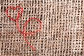 Linen canvas with red heart embroidered on it, close-up — ストック写真